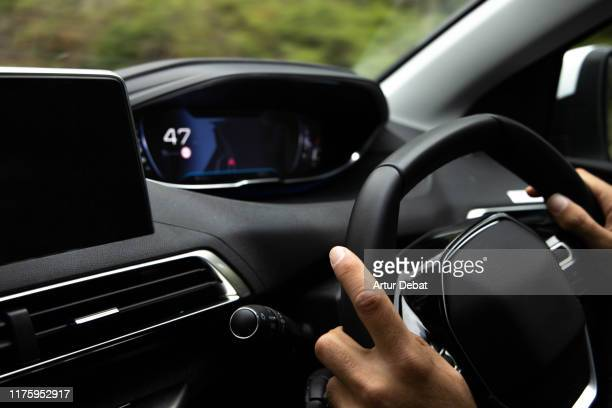 driving smart car with technology and connectivity. - futuristic car stock pictures, royalty-free photos & images