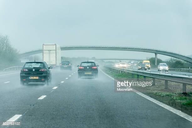 Driving south in heavy rain on M6 motorway, fast lane