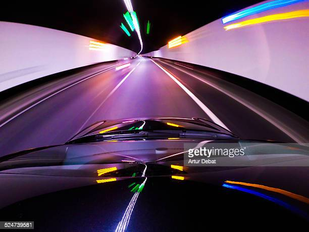 Driving speed car inside tunnel with bright lights