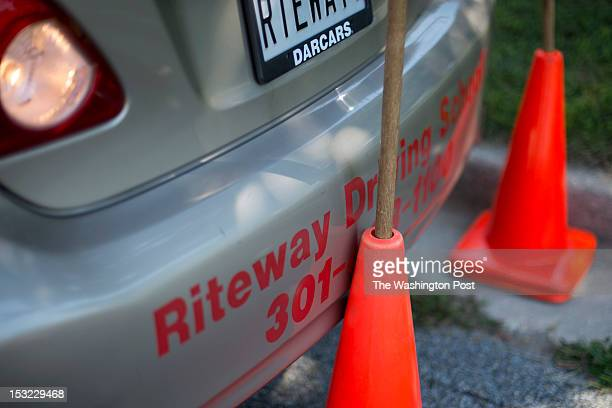 Driving student Christian Kuete hits the cone while parallel parking during a parking lesson in a school parking lot on September 13 2012 in...
