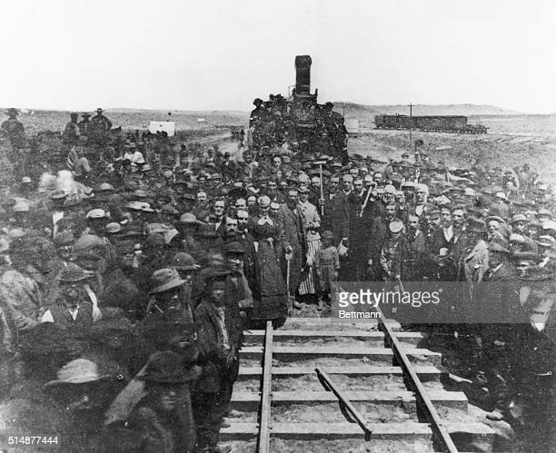Driving the golden spike commerating the completion of the Union Pacific Railroad at Promontory Utah May 10 1869 Photograph
