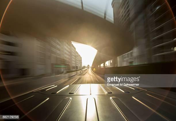 driving through a city / bright sun