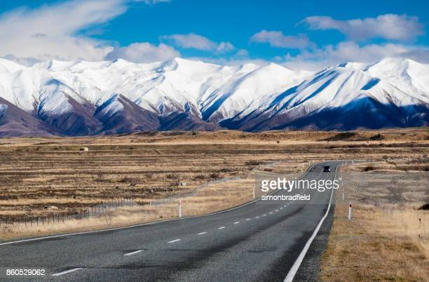 driving through mackenzie country, canterbury, new zealand - new zealand stock pictures, royalty-free photos & images