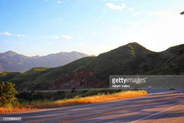 driving through malibu mountains - malibu beach stock pictures, royalty-free photos & images