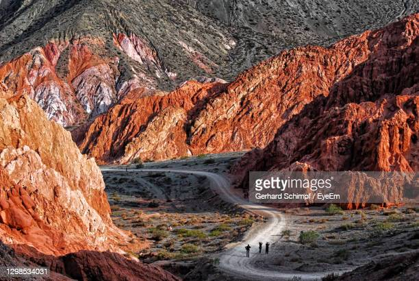 driving through siege colored mountains near purmamarca argentina - gerhard schimpf stock pictures, royalty-free photos & images