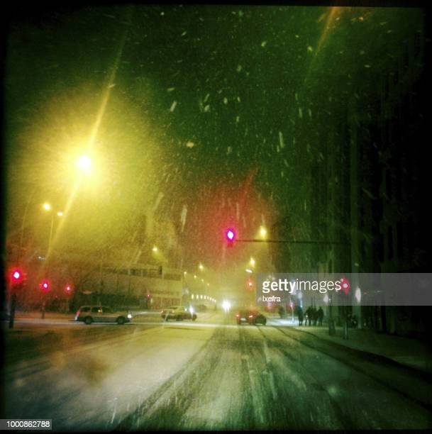 Driving through snow in the city