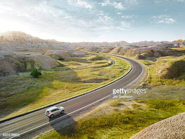 SUV driving through the dramatic landscape of Bandlands National Park
