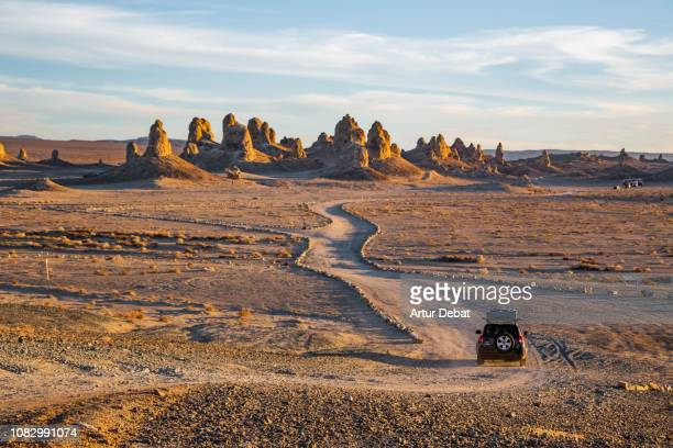 driving through the rock formations of trona pinnacles in the california desert. - canyon stock pictures, royalty-free photos & images
