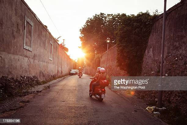 Driving through the streets of Rome, Italy, Fatima Giorgili rides with Scooteroma's Annie Ojile Nerone while Scooteroma's Giovanni Nerone drives...