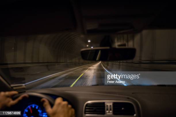 driving through tunnel, lofoten islands, norway - peter adams stock pictures, royalty-free photos & images