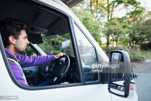 driving to his destination - one mid adult man only stock pictures, royalty-free photos & images