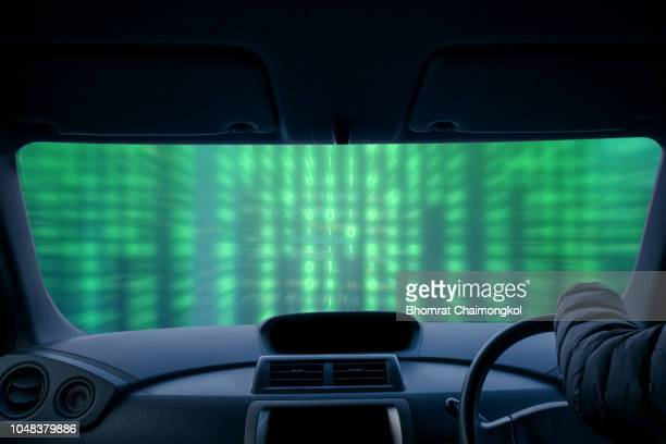 Driving to the future with binary digital technology coding background.