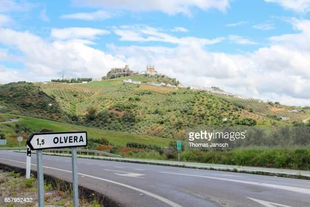 driving towards olvera, one of the white towns (pueblos blancos) of andalusia - pueblo fotografías e imágenes de stock