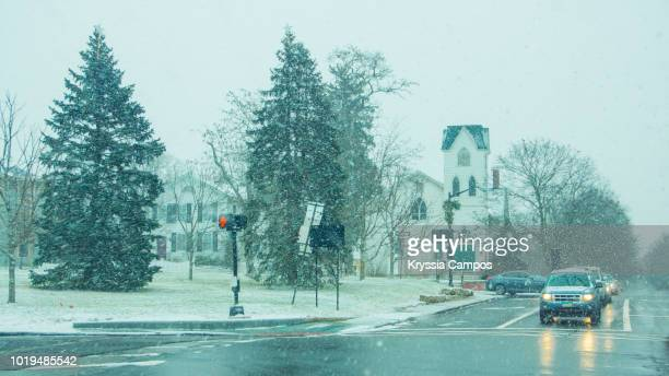 driving under a snowfallin ohio - usa - ohio stock pictures, royalty-free photos & images