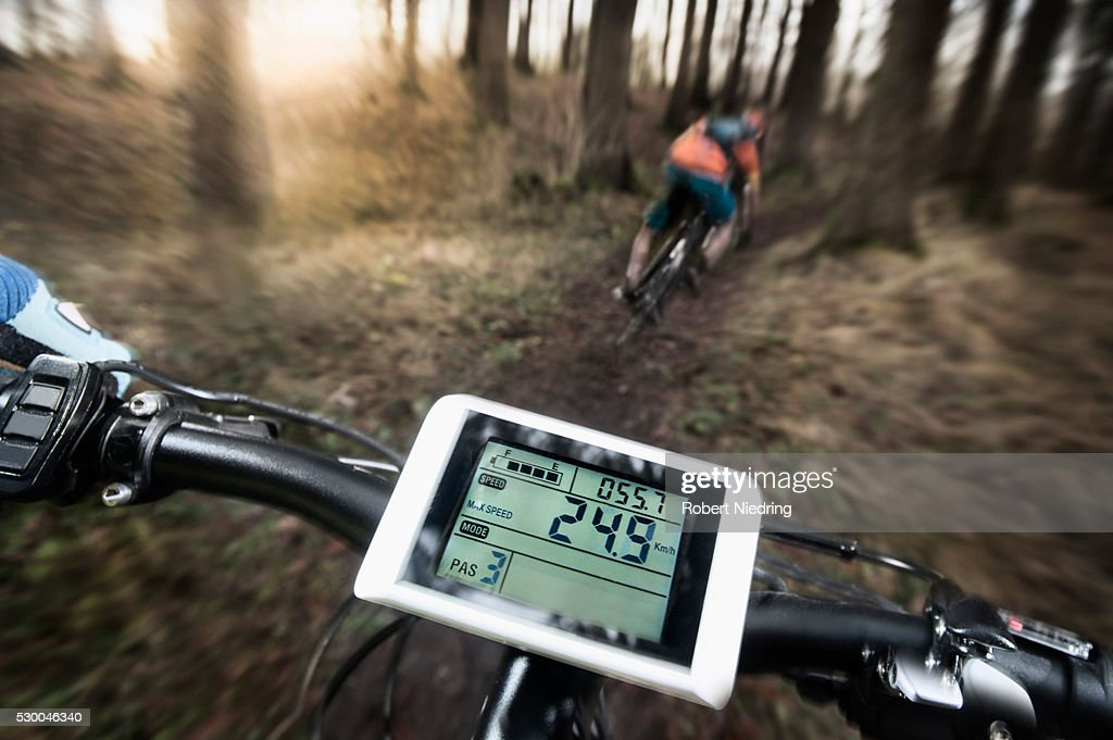 Driving view of mountain biking down hill descending fast on bicycle, Bavaria, Germany : ストックフォト