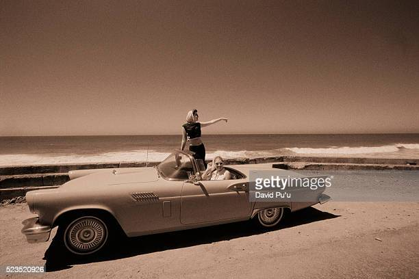 driving vintage car on beach - archival stock pictures, royalty-free photos & images