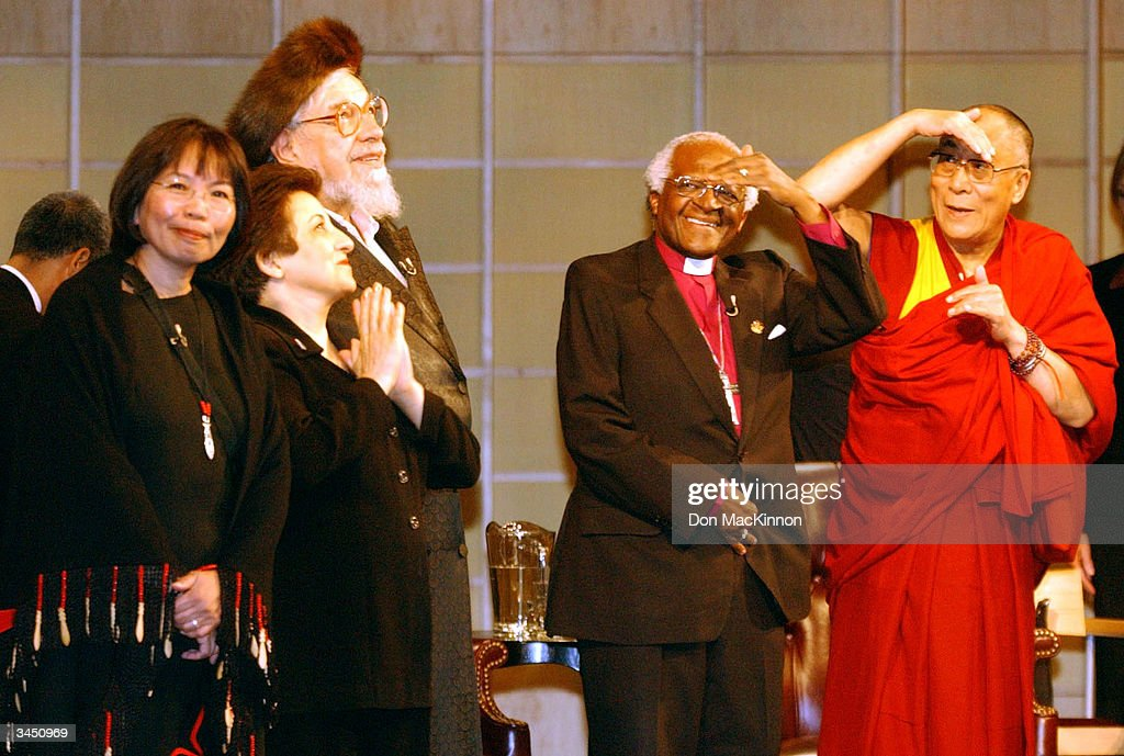 Dr.Jo-ann Archibald, Professor Shirin Ebadi, Rabbi Zalman Schachter-Shalomi, Archbishop Desmond Tutu and His Holiness the 14th Dalai Lama enter the Chan center to applause at the University of British Columbia April 20, 2004 in Vancouver, British Columbia. Nobel Peace Prize Laureates, His Holiness the 14th Dalai Lama, Archbishop Desmond Tutu and Professor Shirin Ebadi, with Rabbi Zalman Schachter-Shalomi and Dr. Jo-ann Archibald took part in round table dialogue where they discussed balancing educating the mind with educating the heart.