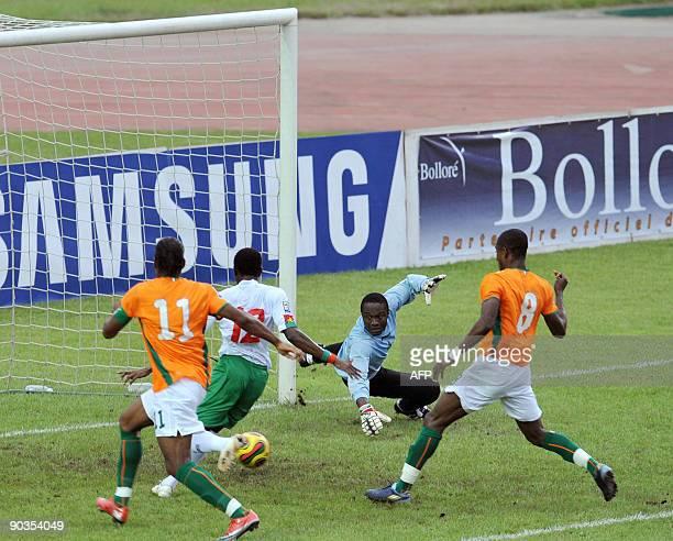 Drogba Didier and Kalou Salomon of 'The Elephants' the Ivory Coast's national football team vie with Panandetiguiri Mady and a goalkeeper Dikite...