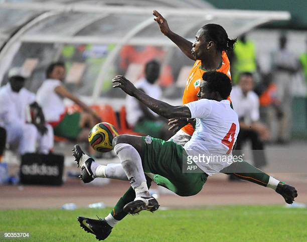 Drogba Didier of 'The Elephants' the Ivory Coast's national football team vies with Tall Mamadou of Burkina Faso on September 5 2009 in Abidjan...