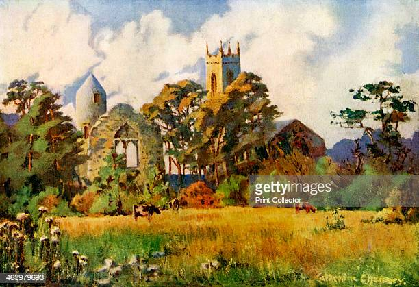 Dromiskin Church County Louth Ireland 19241926 A medieval Irish round tower stands to the left of the church tower A print from Hutchinson's Britain...
