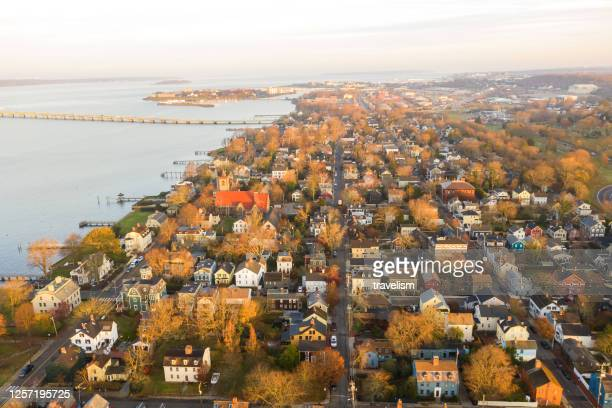drone aerial view of newport phode island old tradition building with ocean and yatch port with street summer season - williamsburg virginia stock pictures, royalty-free photos & images