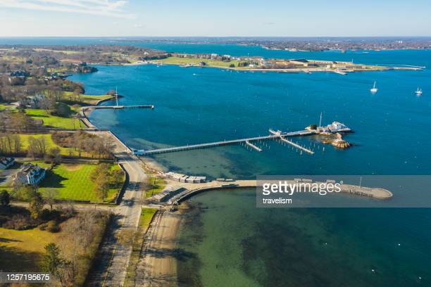 drone aerial view of sunset in newport rhode island at castle hill lighthouse - rhode island stock pictures, royalty-free photos & images