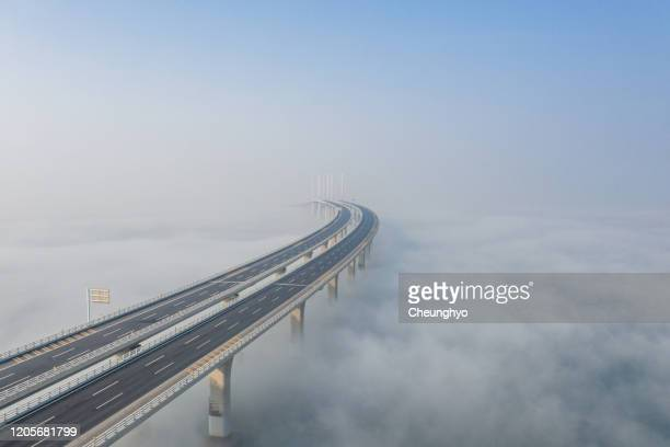 drone aerial view of the jiaozhou bay bridge of qingdao,shandong,china - viaduct stock pictures, royalty-free photos & images