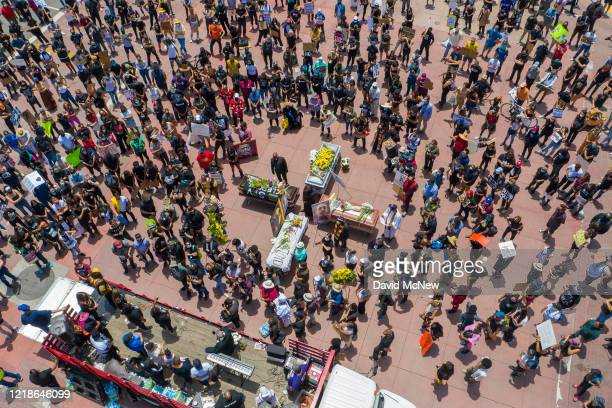 A drone aerial view shows a memorial service for George Floyd and other victims of police killings on a downtown street as demonstrations continue...