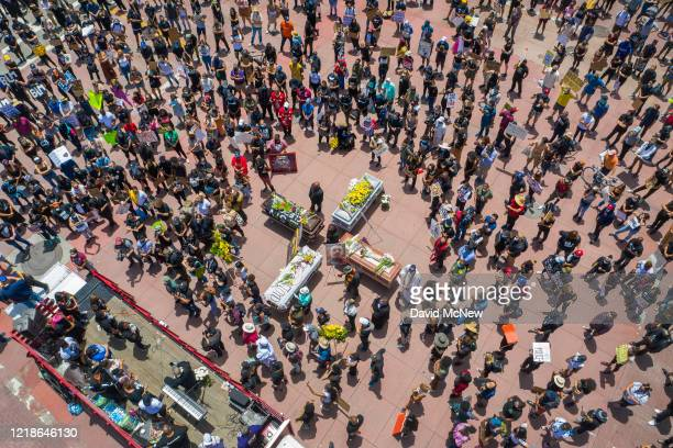 Drone aerial view shows a memorial service for George Floyd and other victims of police killings on a downtown street as demonstrations continue over...