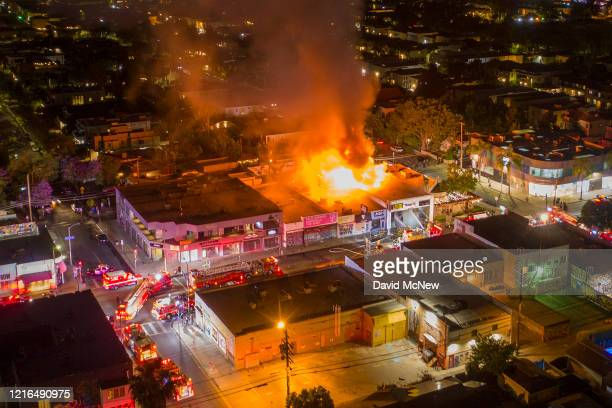 A drone aerial view shows businesses burning in the Fairfax District during demonstrations following the death of George Floyd on May 30 2020 in Los...