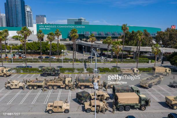 A drone aerial view shows California National Guard troops gathered at the Los Angeles Convention Center after being activated by California Governor...
