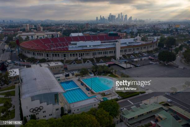 Drone aerial view shows the Los Angeles Swim Stadium and Los Angeles Memorial Coliseum at Exposition Park as Los Angeles County allows more...