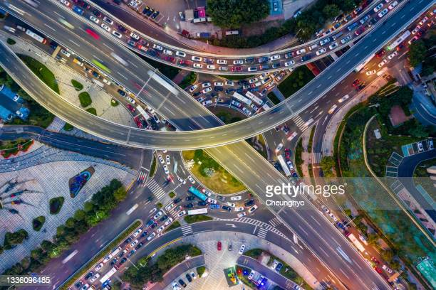 drone aerial view. the traffic situation of the overpass during the rush hour in north district of qingdao city, shandong province, china - qingdao stock pictures, royalty-free photos & images