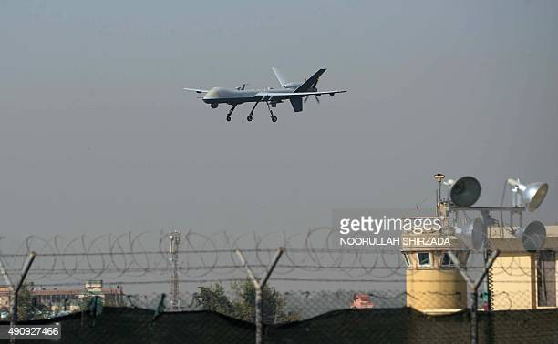 A US drone aircraft lands at Afghanistan's Jalalabad Airport where a US C130 military transport plane crashed in Jalalabad on October 2 2015 The...