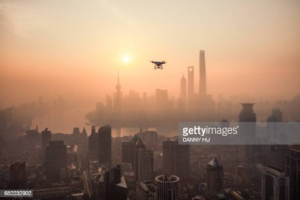 drone and lujiazui skyline in the morning - drone photos et images de collection