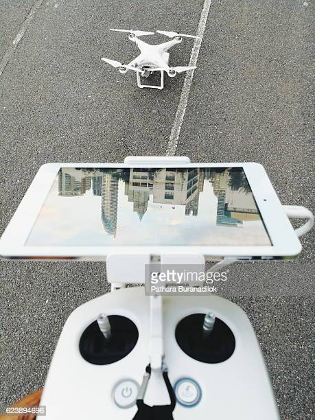 drone and remote controller - military drones stock photos and pictures