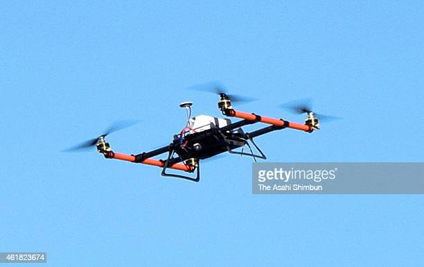 A drone carrying a camera and a first aid kit flies toward Ogijima Island on January 12 2015 in Takamatsu Kagawa Japan During the test the drone...