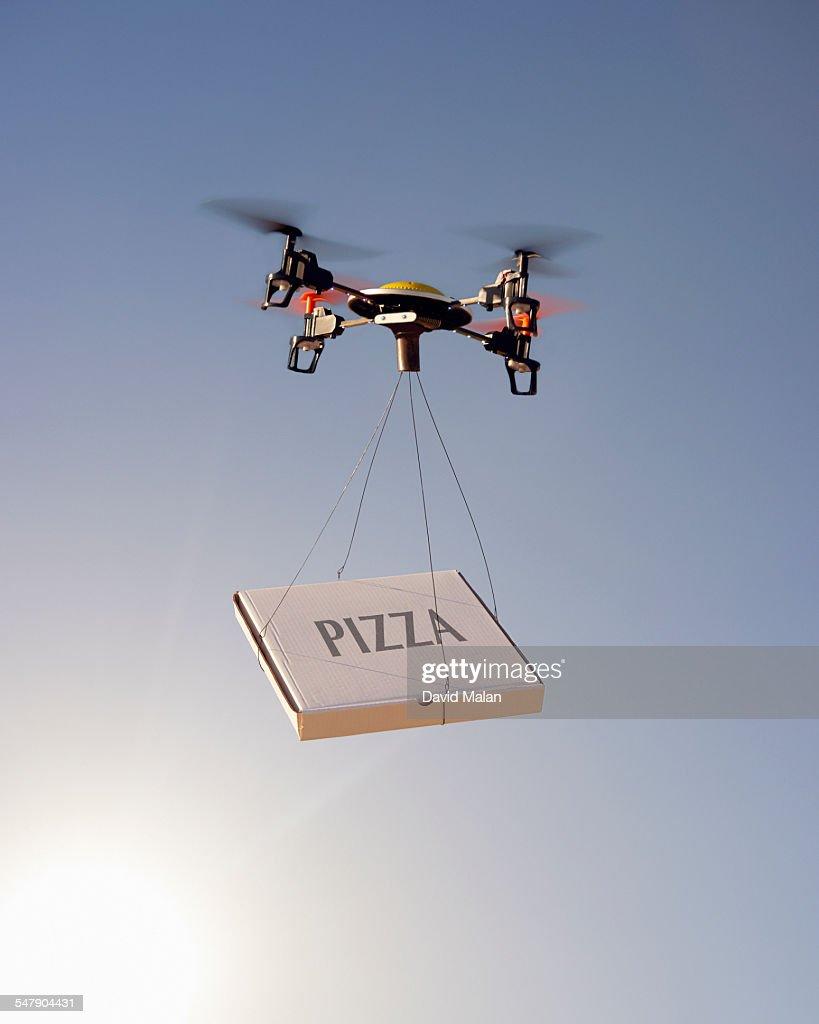 Drone delivering a pizza : Stock Photo