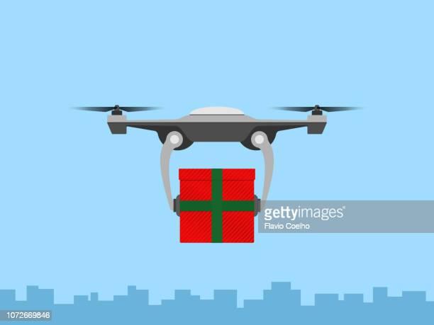drone delivering christmas gift - オクトコプター ストックフォトと画像