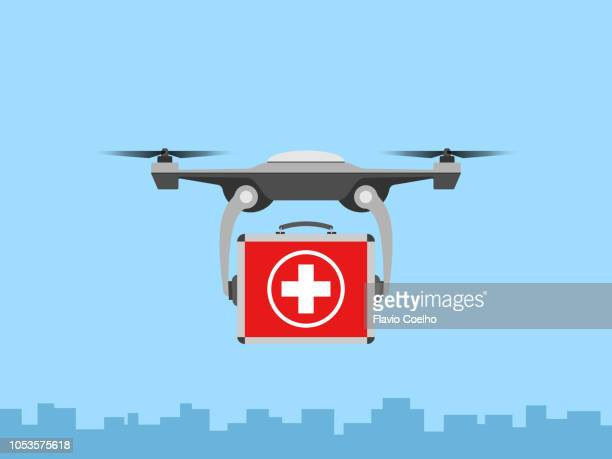 drone delivering first aid kit briefcase - オクトコプター ストックフォトと画像