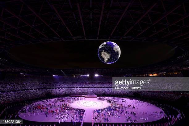 Drone display is seen over the top of the stadium during the Opening Ceremony of the Tokyo 2020 Olympic Games at Olympic Stadium on July 23, 2021 in...