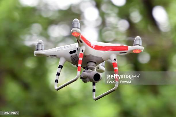 A drone equiped with a photo camera is pictured during a training session of the 17th Parachute Engineer Regiment of Montauban in a forest of the...
