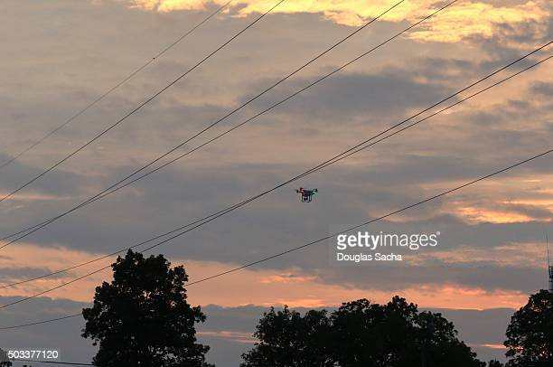 Drone fitted with small HD video camera navigates the overhead wires