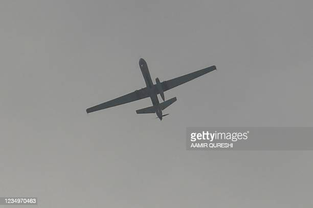 Drone flies over the airport in Kabul on August 31, 2021. - The US military announced it has completed its withdrawal from Afghanistan after a brutal...