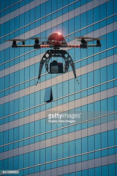 Drone flying and filming a window in a building