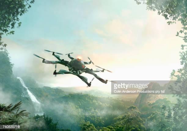 Drone flying near waterfall