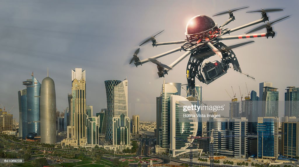 Drone flying over a futuristic city : Stock Photo