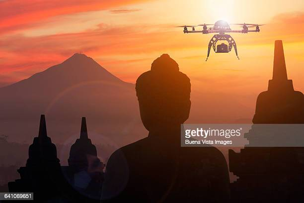 Drone flying over a statue of a Buddhist temple