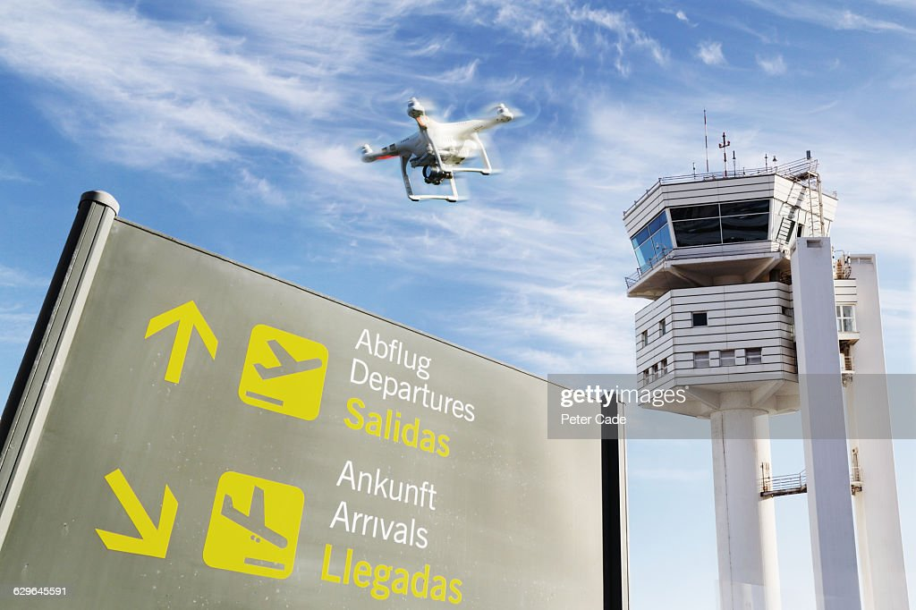 Drone flying over airport : Stock Photo