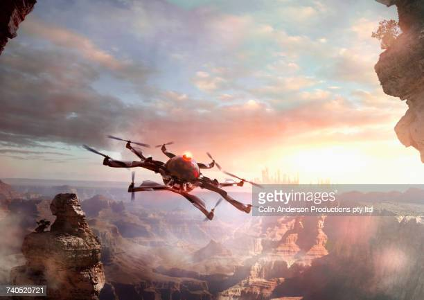Drone flying over canyon at sunset